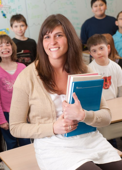 Photo of Amy Frangella in a classroom with her students